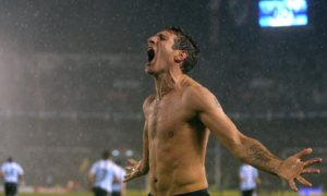 Palermo celebrates his liberation from Shawshank...or a win that was too close against Peru.