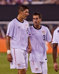 Omar Gonzalez receiving instruction from Carlos Bocanegra in his first USMNT cap against Brazil, August 2010. (Photo credit: Matt Mathai)